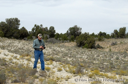 Tom walks carefully near the bladderpod location.